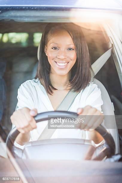 African American Women Driving A Car