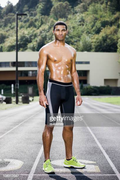 African American Young Male Athlete Runner Sweating on Race Track