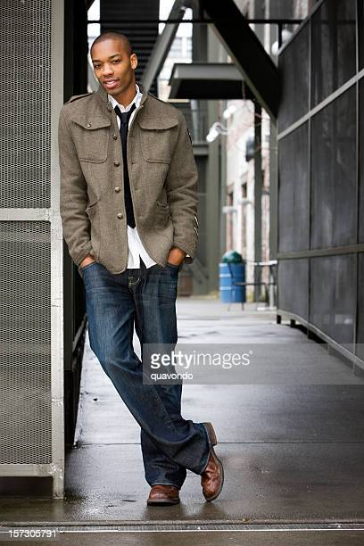 african american young male fashion model in urban setting, copyspace - black alley stock photos and pictures