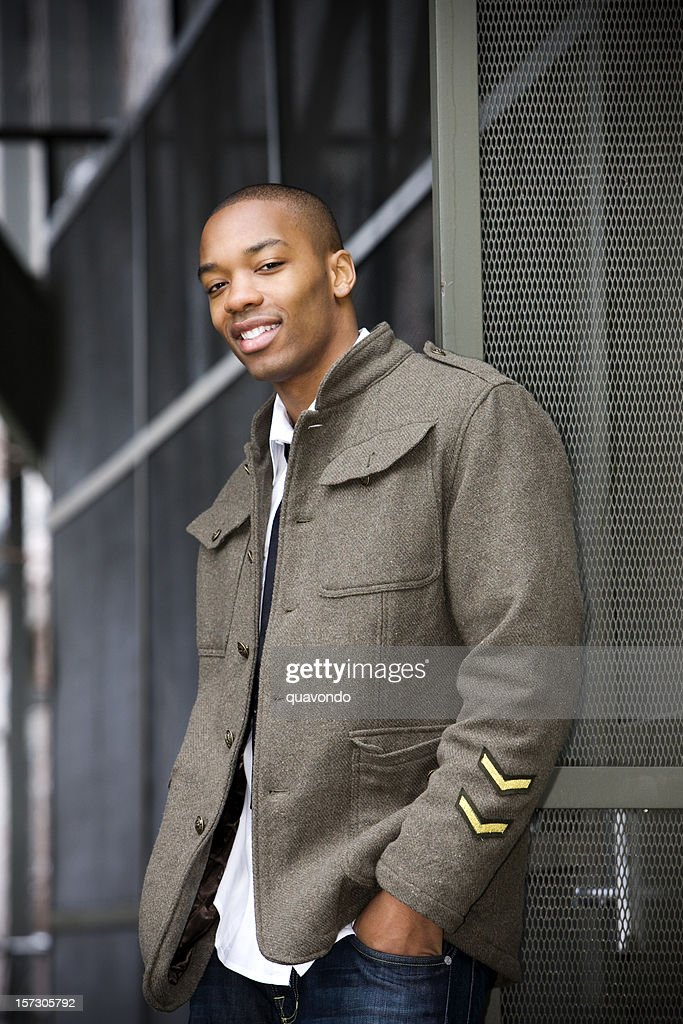 African American Young Male Fashion Model Posing Downtown in Jacket : Stock Photo