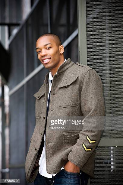 african american young male fashion model posing downtown in jacket - most handsome black men stock photos and pictures