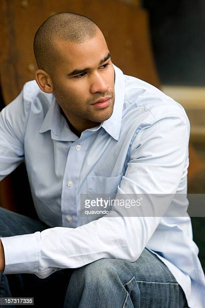 African American Young Man Fashion Model Sitting Outdoors