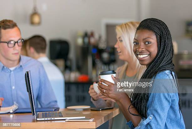 African american young woman drinking coffee while