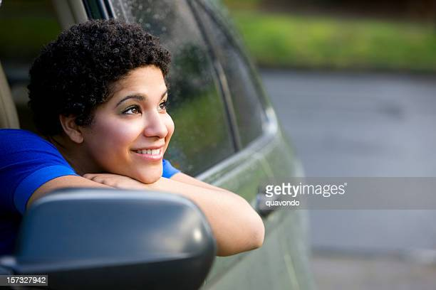 African American Young Woman Leaning Out Car Window Smiling, Copyspace