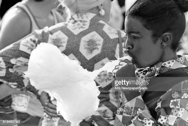 African American youth eating cotton candy during Baltimore City Fair 1976
