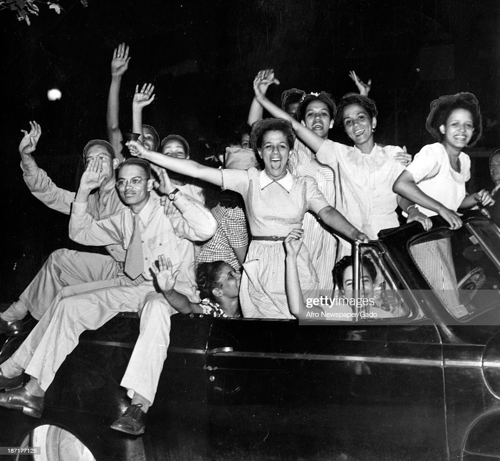 African American youth in a car celebrate victory in Europe at the end of World War 2, Baltimore, Maryland, May 8, 1945.