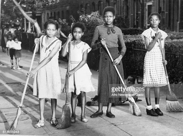 African American youth with brooms during the Afro American Newspapers Clean Block campaign Baltimore Maryland September 28 1935