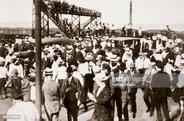 African Americans and whites leaving the beach as trouble begins, Chicago, Illinois, USA, c1919. Racial tensions increased in Chicago after the end...