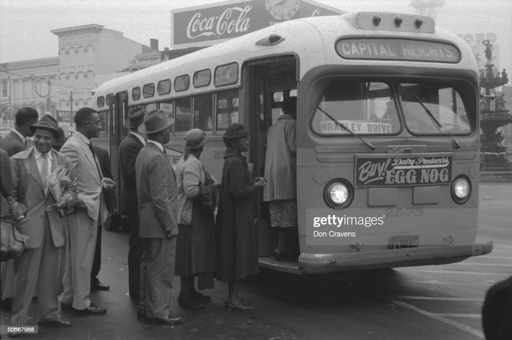 African Americans boarding an integrated : News Photo