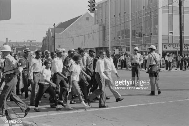 African Americans marching on the corner of 16th Street and 5th Avenue in Birmingham, Alabama, at the start of the Birmingham Campaign, May 1963. The...