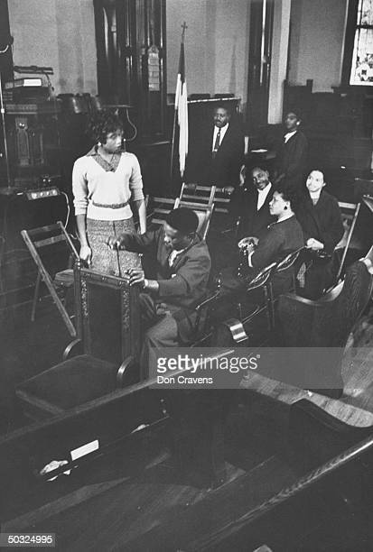 African Americans taking part in excercise in church to demonstrate how to show goodwill to whites on newly integrated buses following Supreme Court...