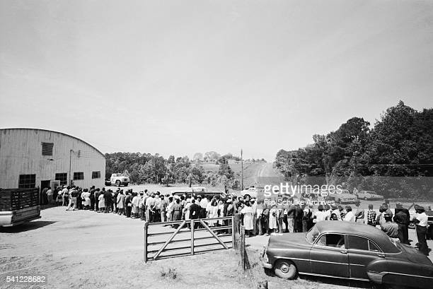 African Americans wait in line to vote for the first time in an Alabama town after enactment of the Voting Rights Act.