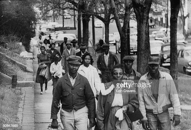 African Americans walk to work instead of riding the bus during the third month of an eventual 381-day bus boycott, Montgomery, Alabama, February...