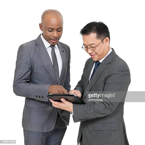 African and Chinese businessmen working together