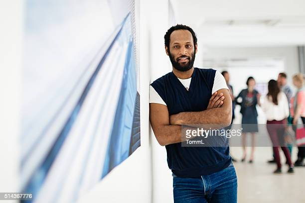 African Artist Portrait In Gallery