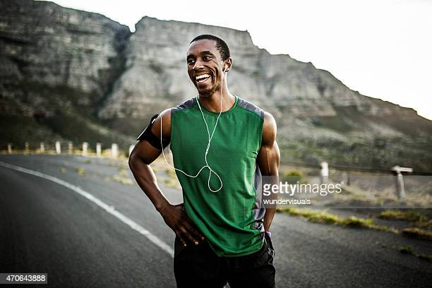 african athlete smiling positively after a good training session - sportsperson stock pictures, royalty-free photos & images