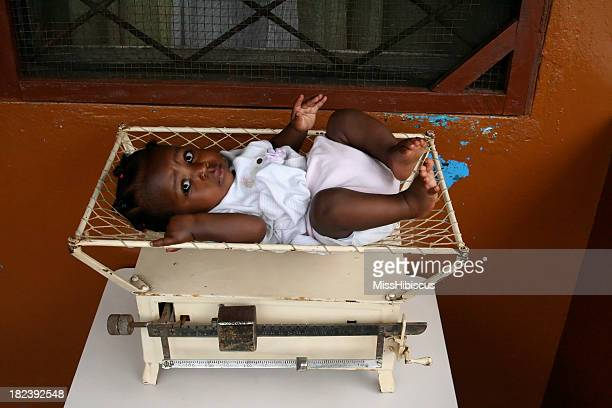 African Baby in Antique Scale
