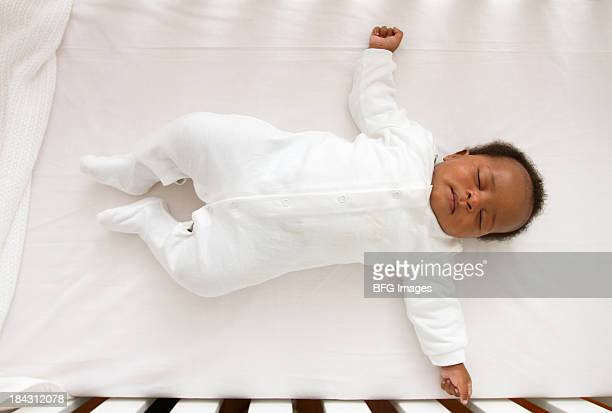 African Baby sleeping in crib, Cape Town, South Africa