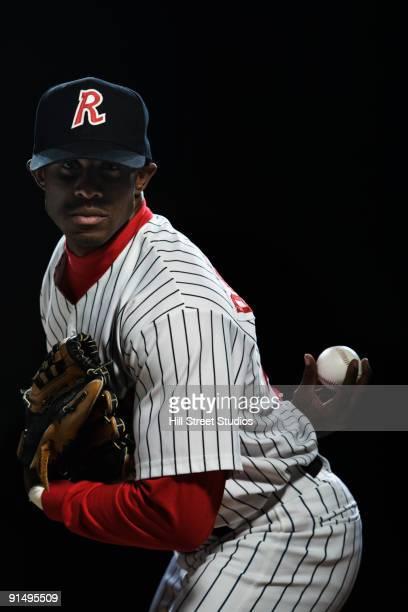 African baseball player pitching