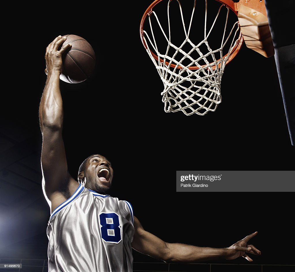 African basketball player scoring : Stock Photo