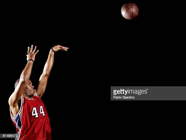 African basketball player shooting basketball