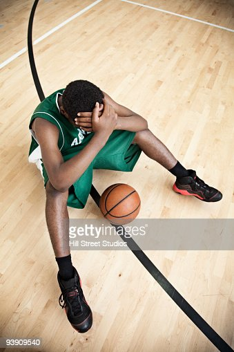 African basketball player with head in hands