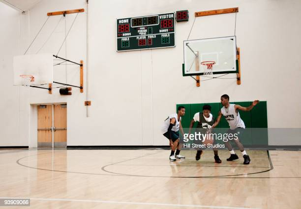 african basketball players practicing in gym - dribbling sports stock pictures, royalty-free photos & images