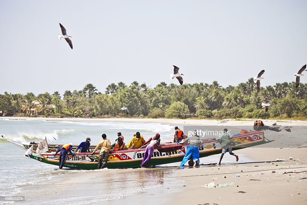 African beach scene with fishing boat. : Stock Photo