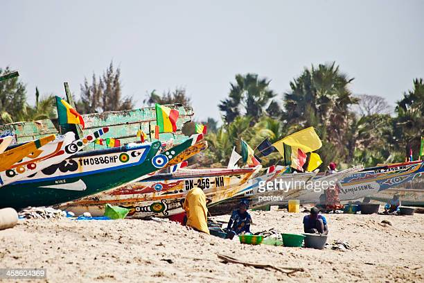 African beach scene with fishing boats.