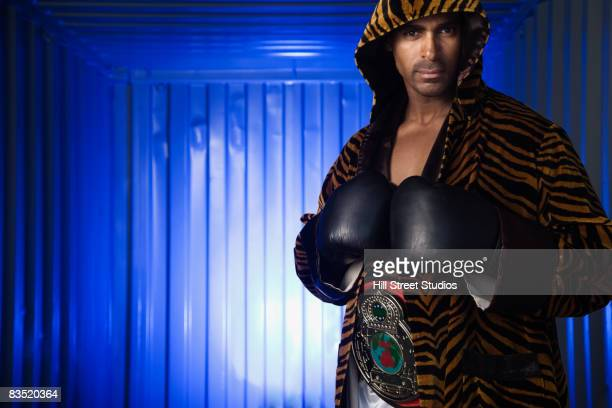 african boxer with championship belt  - boxing belt stock pictures, royalty-free photos & images