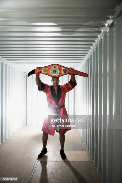 African boxer with championship belt