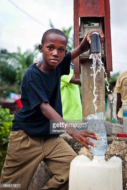 African Boy By Water Pump