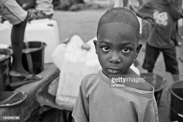 African Boy By Water Pump