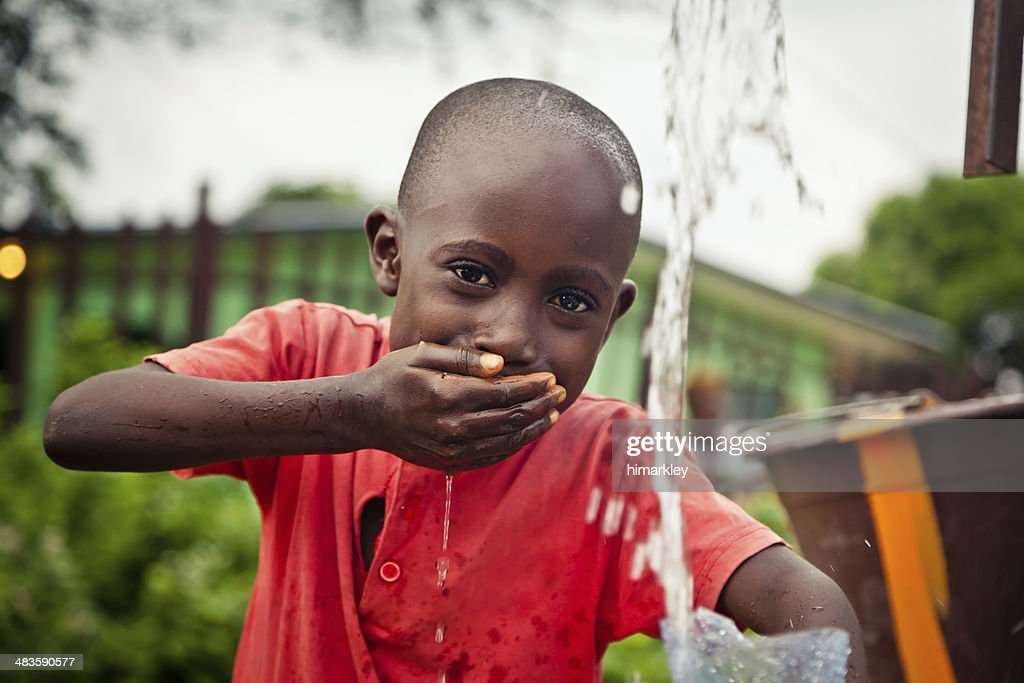 African Boy By Water Pump : Stock Photo