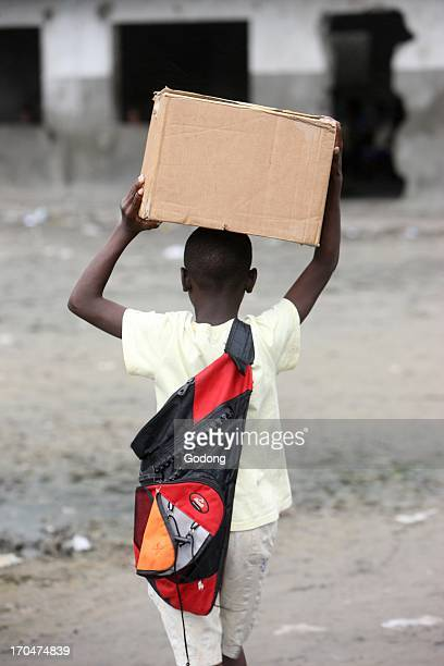 African boy carrying a box Brazzaville Congo