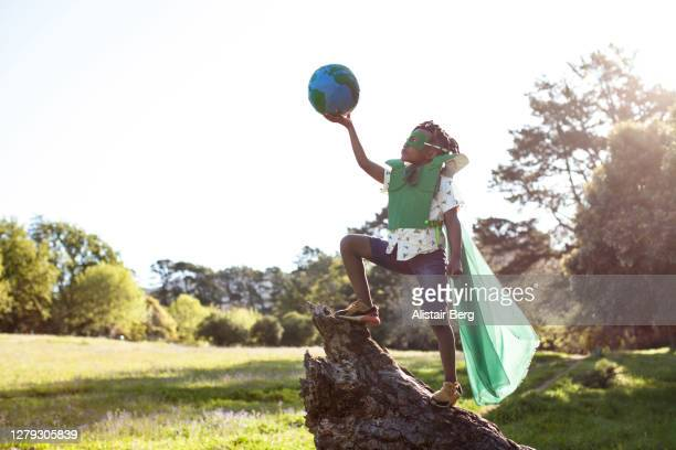 african boy dressed as an eco warrior - campaigner stock pictures, royalty-free photos & images