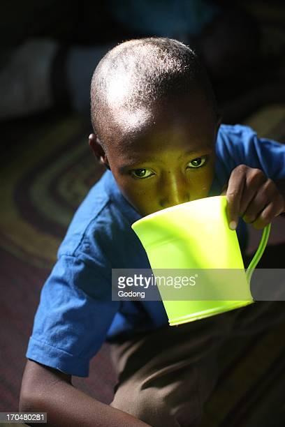 African boy drinking Bamako Mali