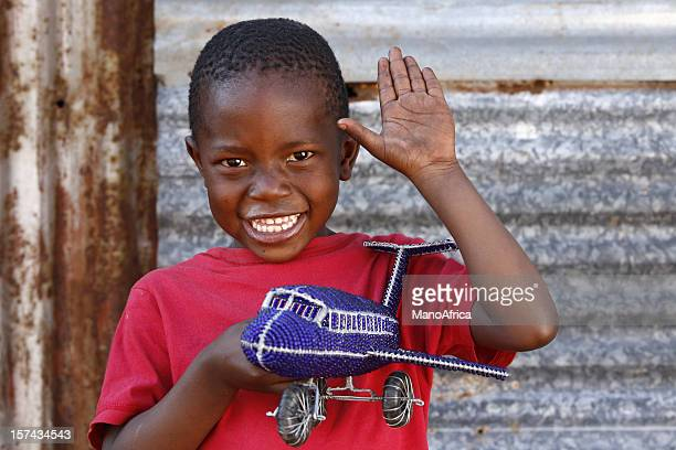 African boy greeting