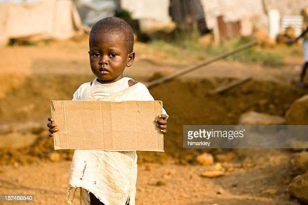 African Boy holding a blank cardboard sign
