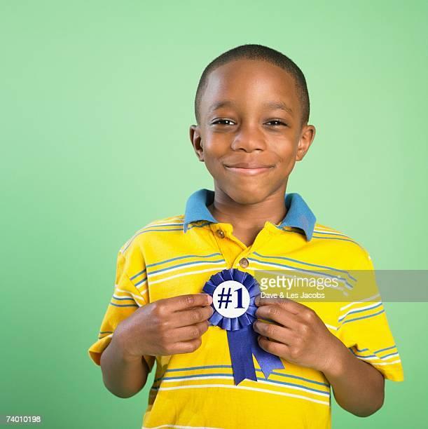 African boy holding birthday ribbon