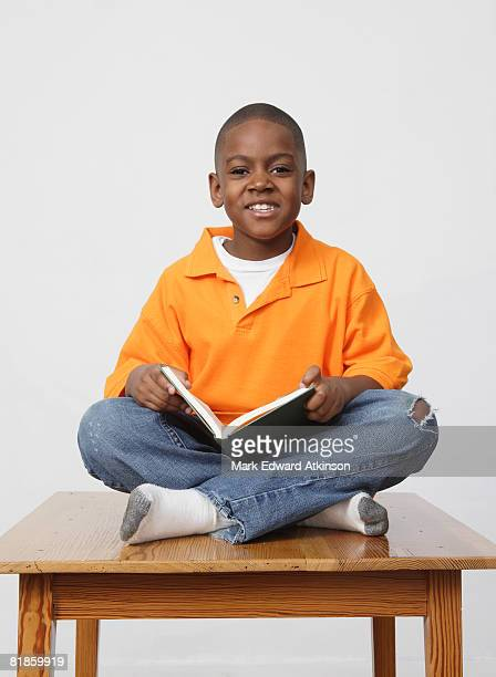 African boy holding book