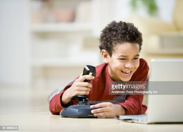 African boy playing video games