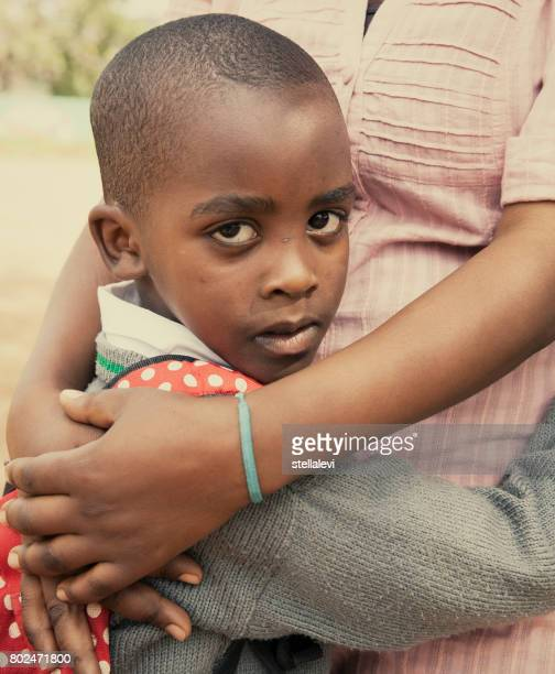 African Boy portrait with his mother, East Africa