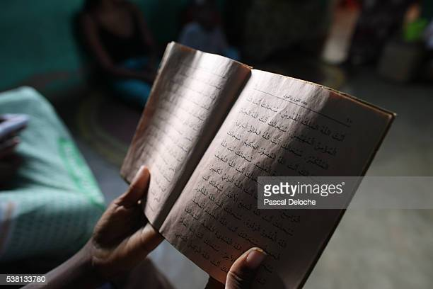 african boy reading the quran. - holy quran stock pictures, royalty-free photos & images