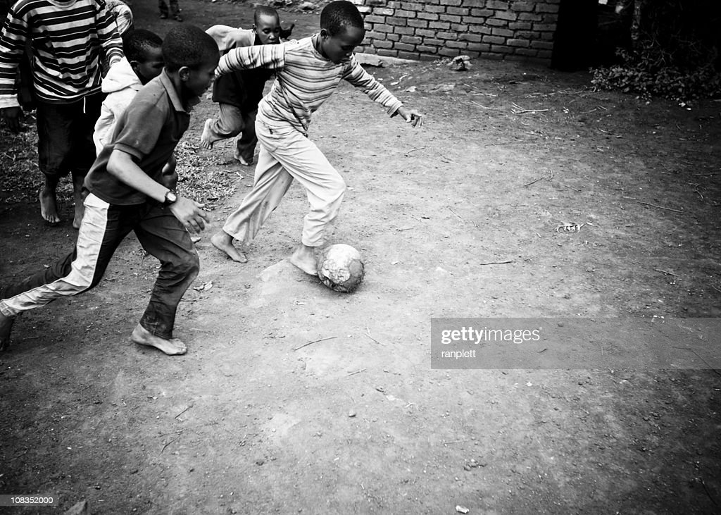 African Boys Playing Soccer : Stock Photo