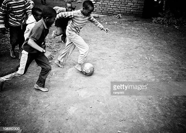 African Boys Playing Soccer