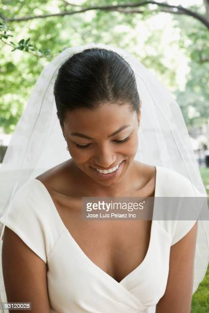 African bride smiling and looking down