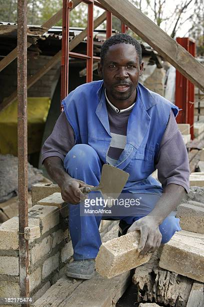 African building his own home