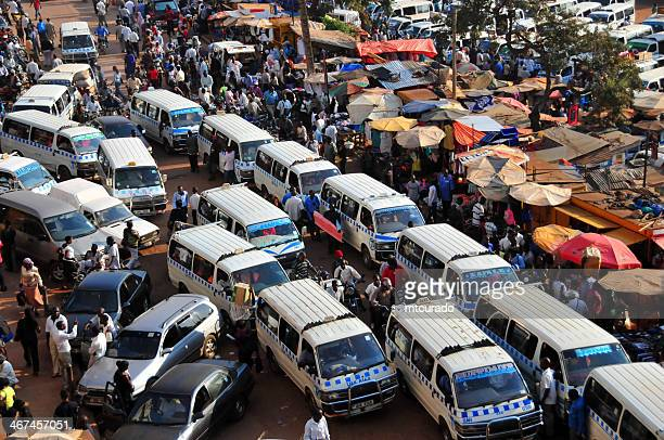 african bus station - share taxi agglomeration, kampala, uganda - kampala stock pictures, royalty-free photos & images