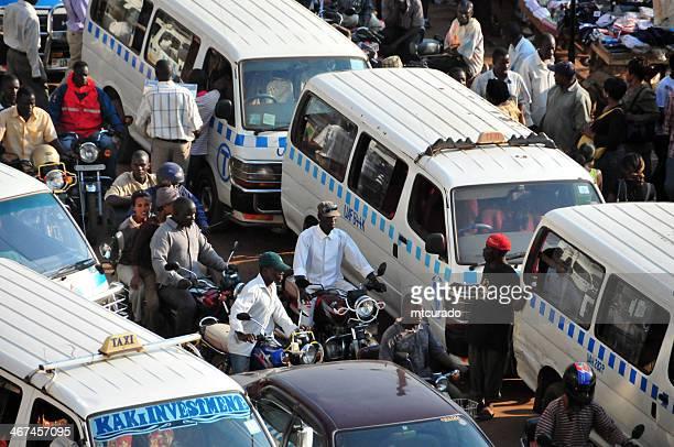 african bus station - share taxi agglomeration, kampala, uganda - uganda stock pictures, royalty-free photos & images